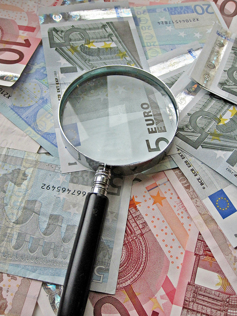 Euro Notes under magnifying glass by Images_of_Money